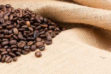 Foto op Canvas koffiebar sackcloth full of coffee beans