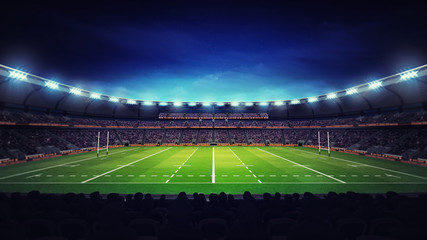 illuminated modern rugby stadium with spectators and green grass