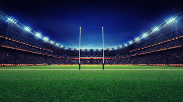 huge rugby stadium with fans and green grass