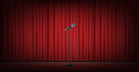 microphone stand on stage with red curtain background