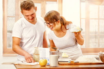 Young Couple Baking Yeast Cake