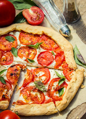 Home biscuit pizza with feta cheese, tomato and basil.