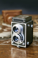 Twin-lens reflex camera on wooden table