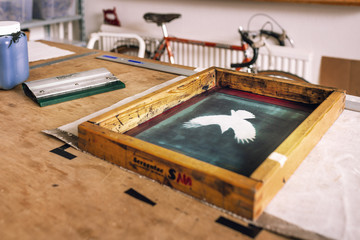Close-up of screen printing frame on table in bag factory