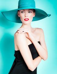 Fashion portrait of female wearing hat.