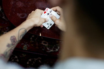 Cropped image of man playing cards at home