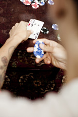 Cropped image of man playing poker at home