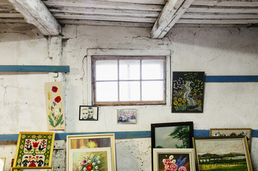 Picture frames and painting in old room