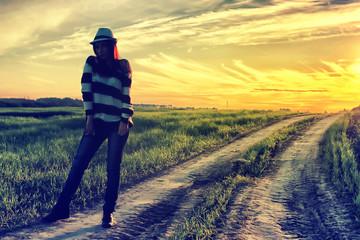 girl in hat fashion field sunset