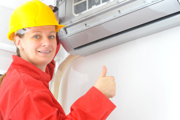 Female electrician fixing electricity problem