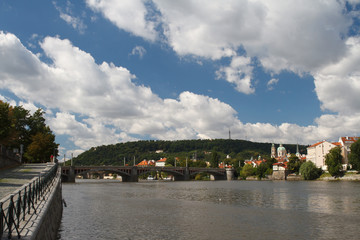 Vltava River in Prague. View from the embankment to the bridge and Prague Castle