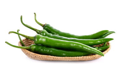 Wall Mural - Green chilli pepper in basket on white background