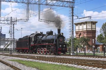Demonstration of restored vintage locomotives in Moscow. Steam locomotive series er-774-38 rides