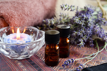 essential oils with lavender and candle