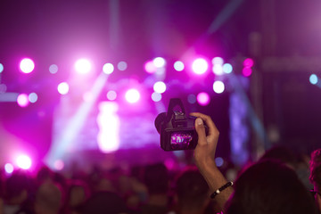 Fan Taking Photo On Camera At Music Festival