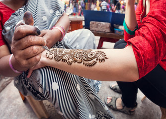Henna painting in India