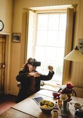 Hipster enjoying while using virtual reality simulator