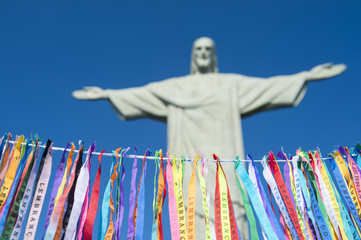 Fita do Bonfim Brazilian wish ribbons strung in blue sky at Corcovado Christ the Redeemer statue Rio de Janeiro
