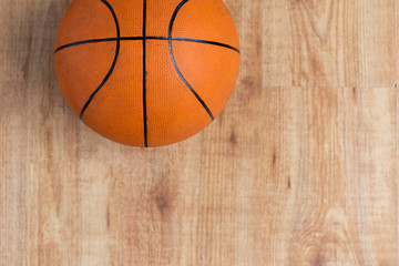 close up of basketball ball on wooden floor