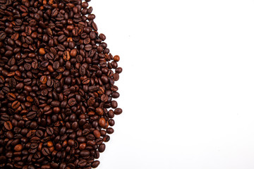Frame of roasted coffee beans isolated on white