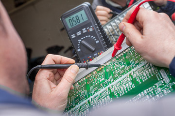 Checking circuit by Multimeter. Electrical engineer on during ch