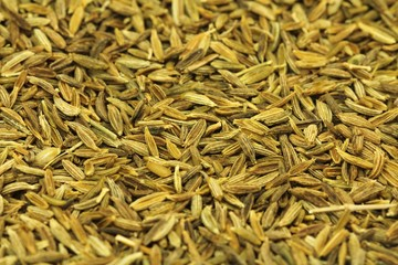 dried cumin grains abstract background
