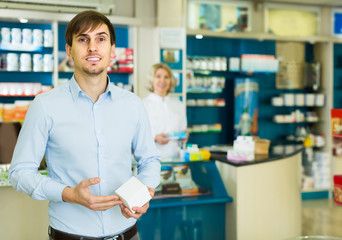 Handsome man   in pharmacy drugstore