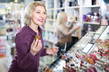 woman selecting face powder