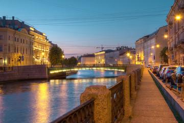 Night view on illuminated Moyka River and Fonarny Bridge from embankment, St. Petersburg, Russia.