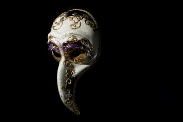 Traditional Venice Mask with Big Nose on Black Background