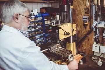 Horologist using a horological milling machine