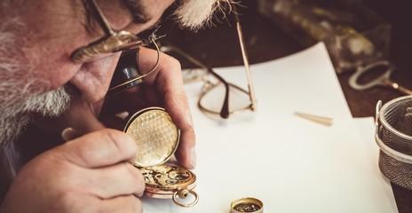 Horologist repairing a pocket watch