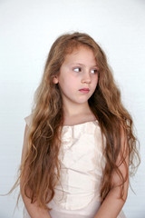 little girl with long hair looking away from camera