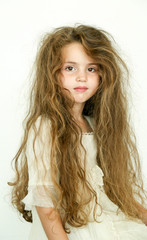 little girl with long messy hair