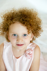 little girl with very curly hair