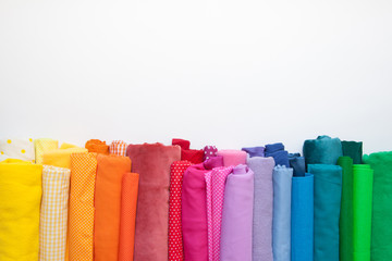 Aluminium Prints Fabric Rolls of bright colored fabric on a white background.