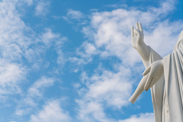 Hands of goddess Guanyin with blue sky and copy space. - Chinese goddess statue (a public temple , can take picture )