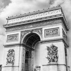 A black and white photo of the famous Arc de Triomphe, Paris, France