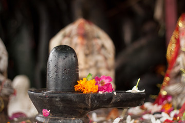 A Shiva Lingam in a shrine in India