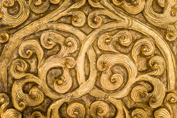 Swirling gold metalwork design.