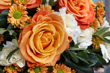 Bouquet of orange roses and white carnation flowers