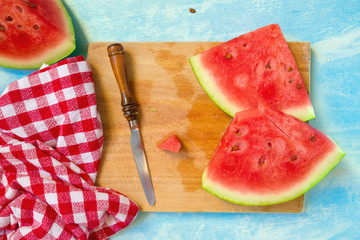 Watermelon slices on cutting board, top view
