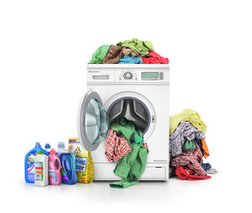 Concept of a big washing. Clothes falling from the washing machi