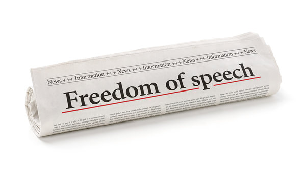 Rolled newspaper with the headline Freedom of speech