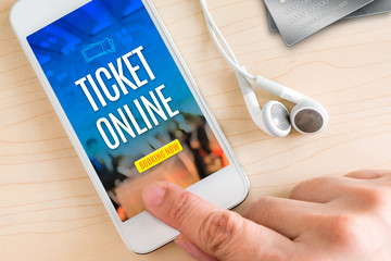 Hand touch smart phone and ear phone with Ticket online word on