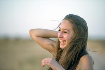 Cute Teenager Having Fun Alone at Sunset