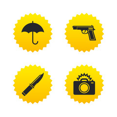 Gun weapon. Knife, umbrella and photo camera.