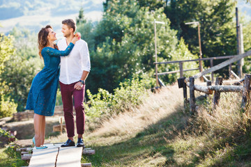 Embracing couple in the countryside