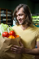 Man holding bag of vegetables