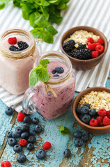 Well being and weight loss concept, berry smoothie and oatmeal w